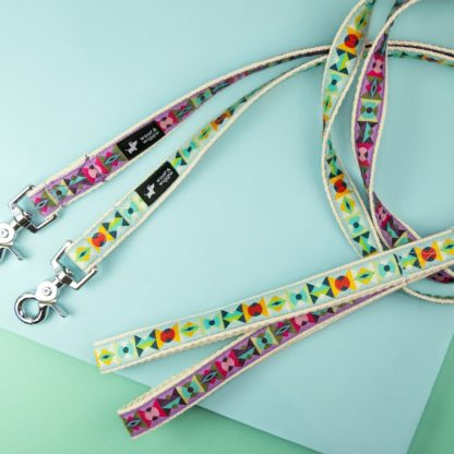 Dog leashes with abstract patterns in purple and turquoise