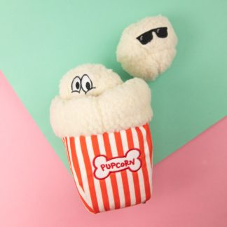 Dog toys from P.L.A.Y. in the form of a popcorn bag