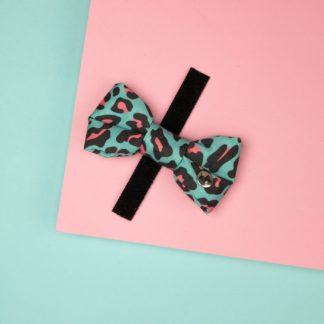 Dog bow tie made of blue-pink leopard print