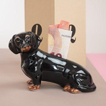 Money box in shape of a dachshund
